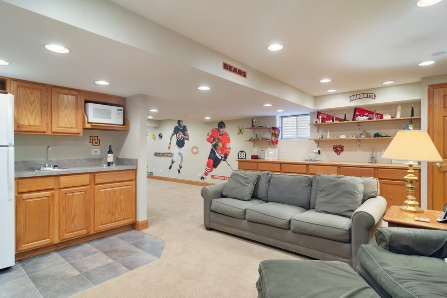Real Estate Photography - 18 S Louis St, Mount Prospect, IL, 60056 - Recreation Room with Kitchenette/Built-ins