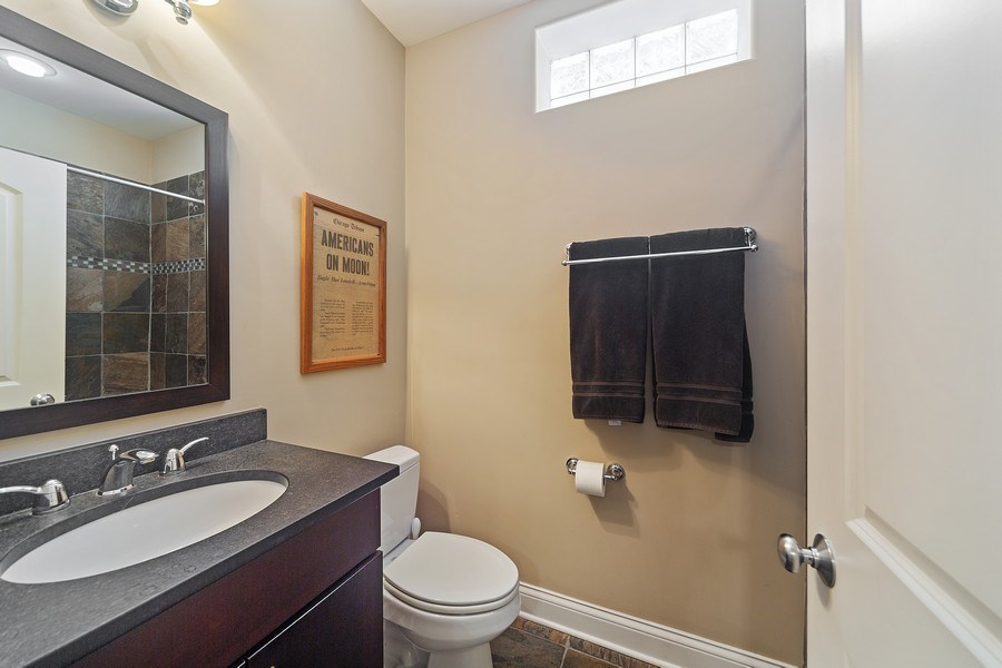 Real Estate Photography - 814 W. Buckingham Ave., Unit 1, Chicago, IL, 60654 - Lower Level Bathroom