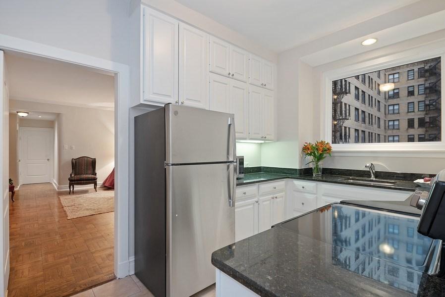 Real Estate Photography - 222 E Chestnut St, Unit 7D, Chicago, IL, 60611 - Kitchen / Living Room