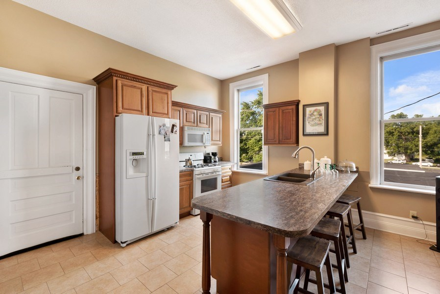 Real Estate Photography - 26 N Whittaker St, New Buffalo, MI, 49117 - Apartment Kitchen/Dining