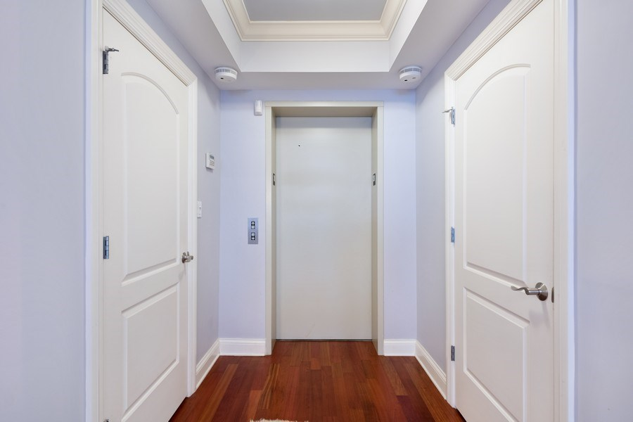 Real Estate Photography - 506 W Roscoe, #302, Chicago, IL, 60657 - Entryway with in-unit elevator access
