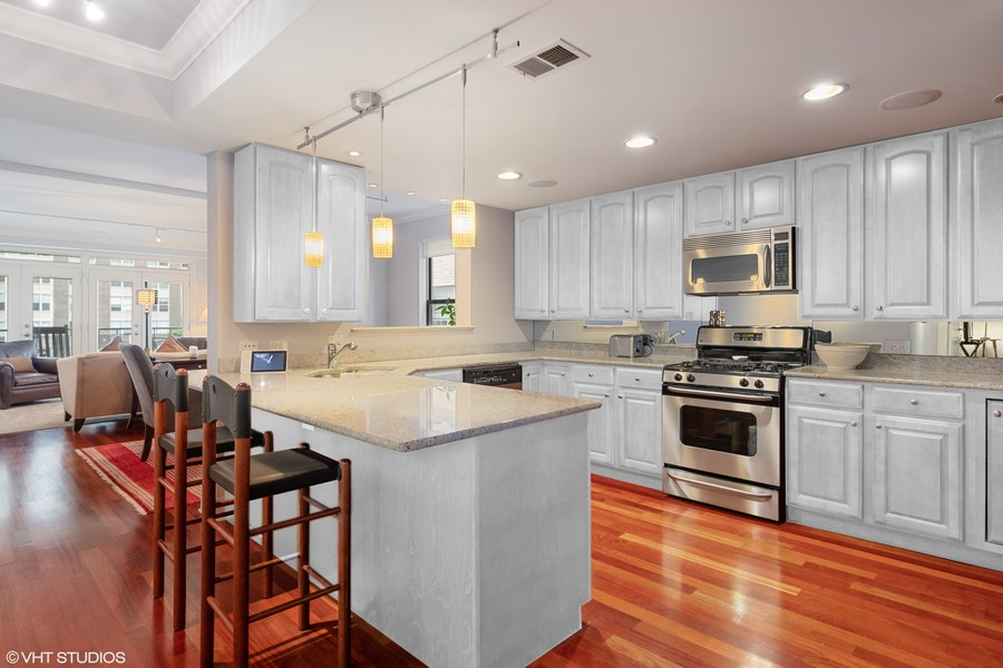 Real Estate Photography - 506 W Roscoe, #302, Chicago, IL, 60657 - Kitchen shown with cabinets digitally painted ligh