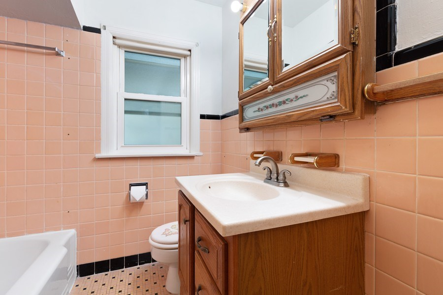 Real Estate Photography - 5405 W Hutchinson St, Chicago, IL, 60641 - Bathroom