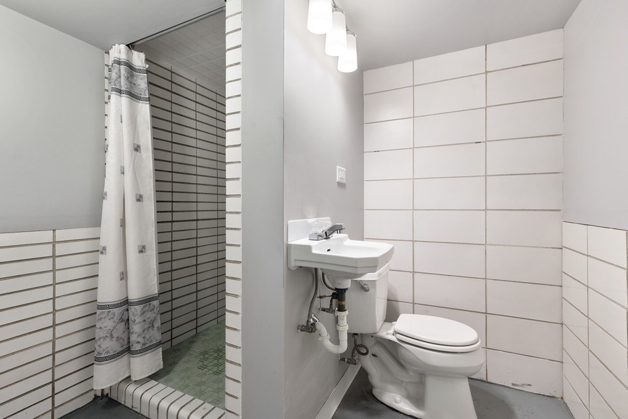 Real Estate Photography - 5405 W Hutchinson St, Chicago, IL, 60641 - 2nd Bathroom