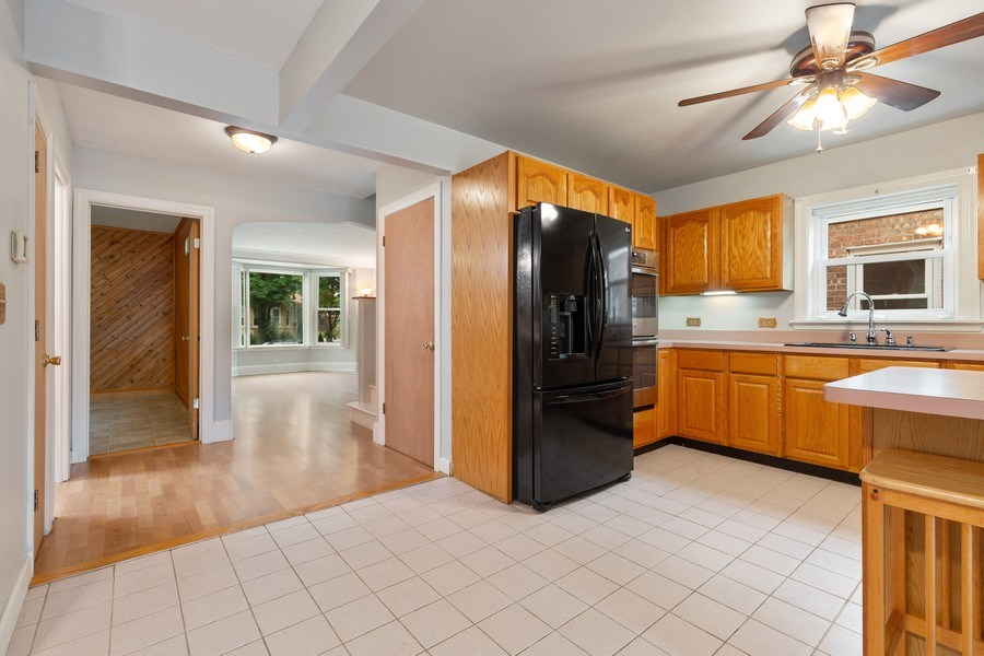 Real Estate Photography - 5405 W Hutchinson St, Chicago, IL, 60641 - Kitchen / Living Room