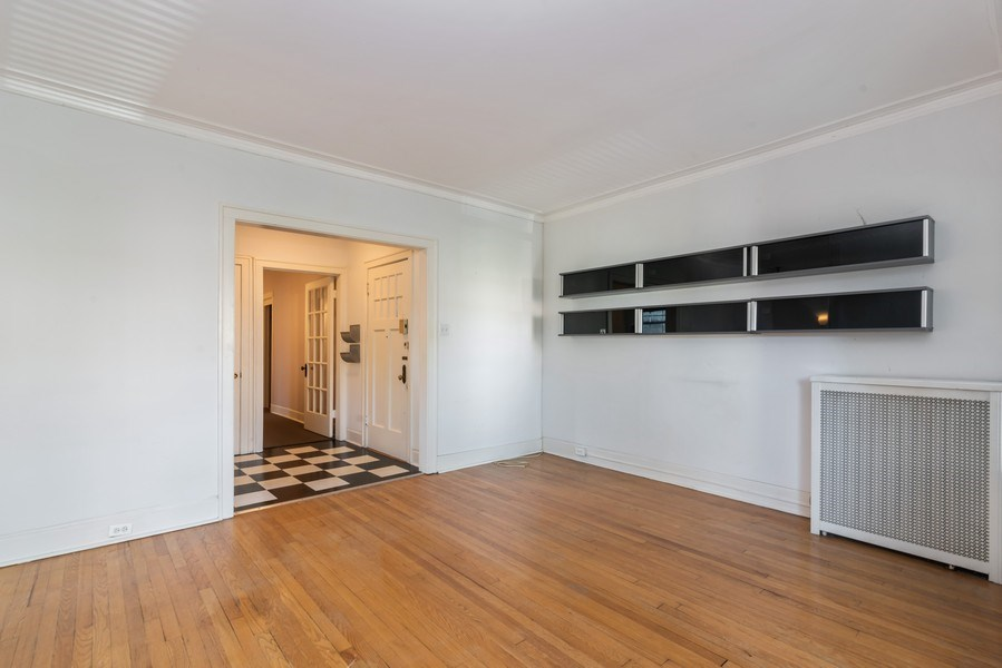 Real Estate Photography - 7729 N. Ashland, Apt 2N, Chicago, IL, 60626 - Living room - view toward south wall/foyer/front d