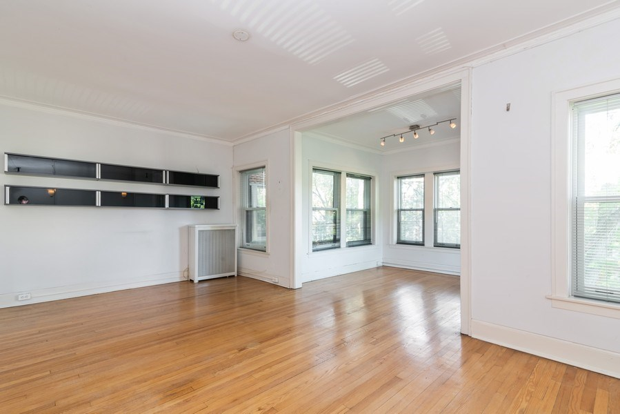 Real Estate Photography - 7729 N. Ashland, Apt 2N, Chicago, IL, 60626 - Living room - view toward south side
