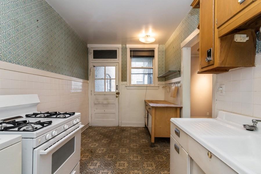 Real Estate Photography - 7729 N. Ashland, Apt 2N, Chicago, IL, 60626 - Kitchen view toward back door/deck