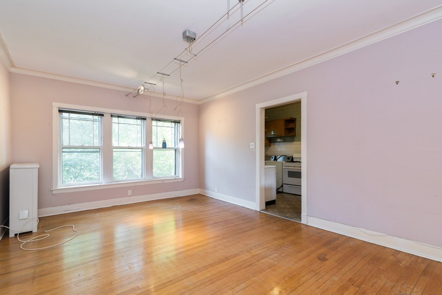 Real Estate Photography - 7729 N. Ashland, Apt 2N, Chicago, IL, 60626 - Dining room with north window facing tree tops