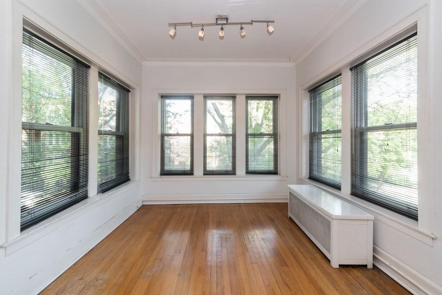 Real Estate Photography - 7729 N. Ashland, Apt 2N, Chicago, IL, 60626 - Sun room w/tree top views