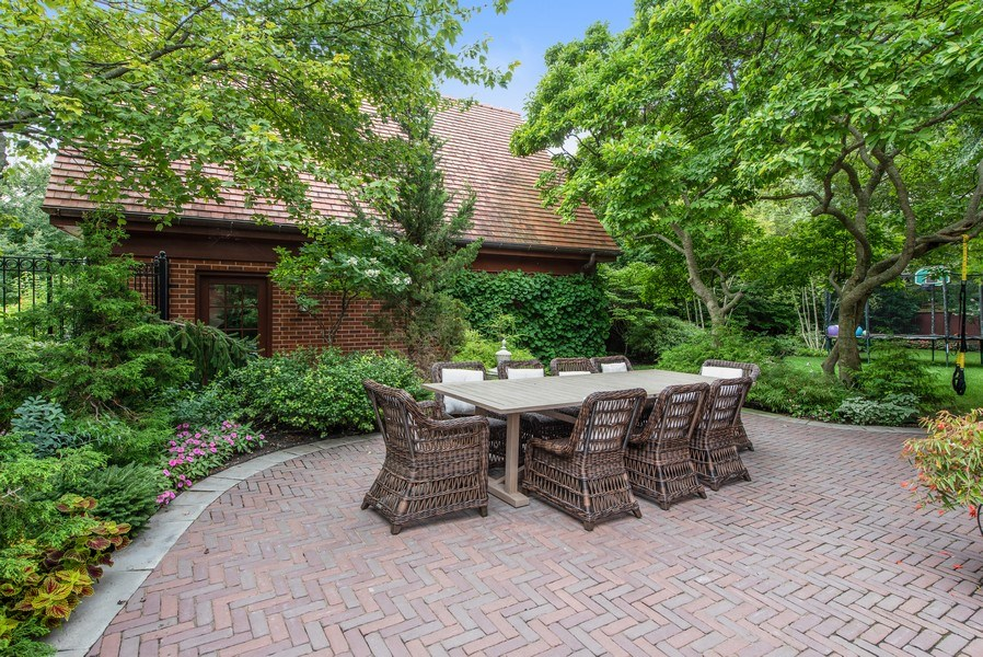 Real Estate Photography - 1225 Sheridan Rd, Evanston, IL, 60202 - Backyard Dining Area and 2 Car Detached Garage