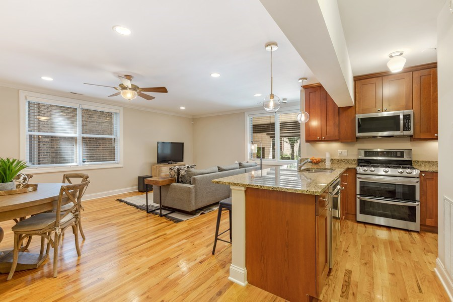 Real Estate Photography - 830 W Bradley Pl, Unit 1S, Chicago, IL, 60613 - Kitchen/Living