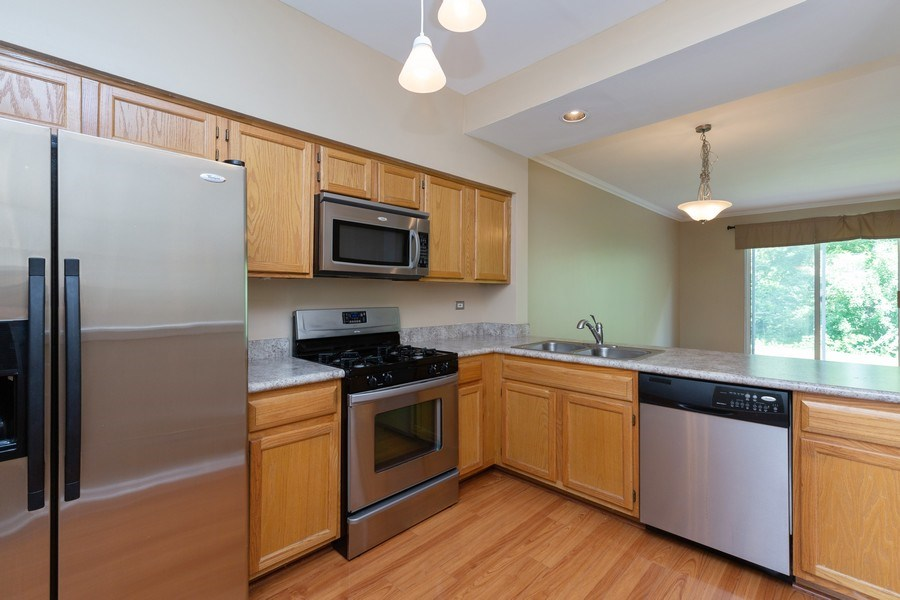Real Estate Photography - 137 Polaris, Lake in the Hills, IL, 60156 - Kitchen