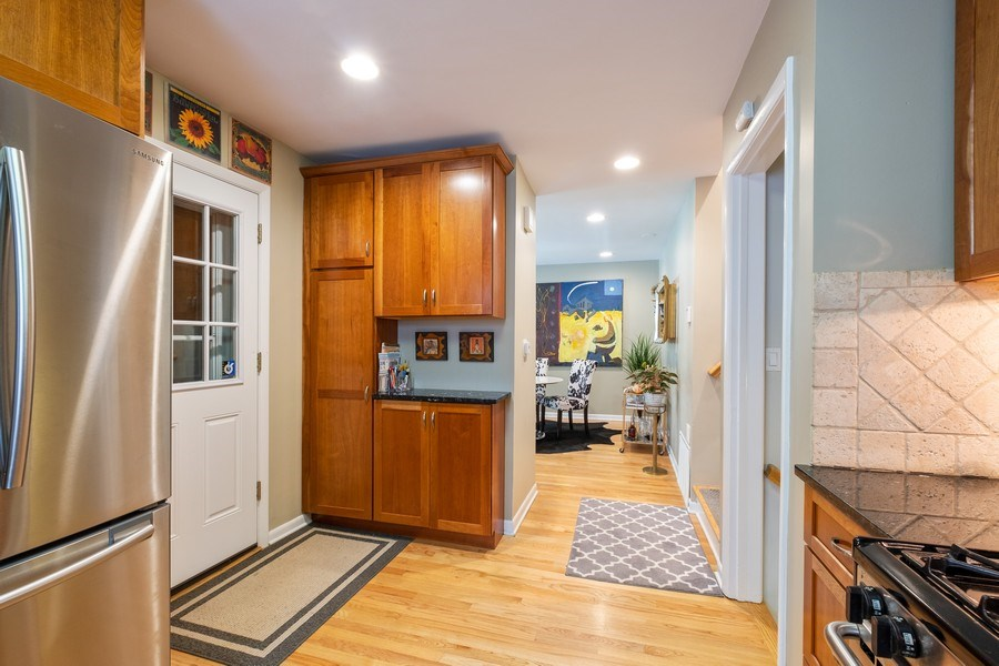 Real Estate Photography - 622 Pleasant Ave, Highland Park, IL, 60035 - Kitchen open to Dining Room