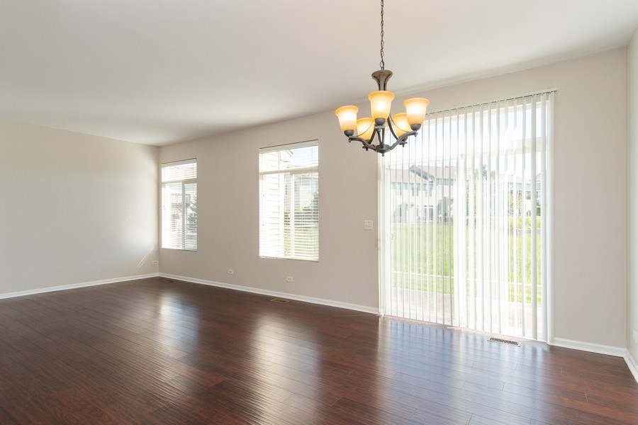 Real Estate Photography - 2212 Summerlin Dr, Aurora, IL, 60503 - Family Room / Dining Room