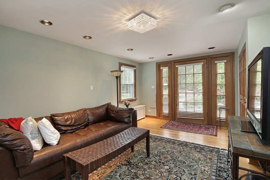 Real Estate Photography - 399 Jackson, Glencoe, IL, 60022 - Foyer currenly used as a cozy tv room