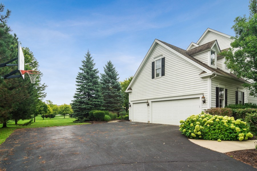 Real Estate Photography - 28385 W Harvest Glen Cir, Cary, IL, 60013 - 3 Car Side Load Garage