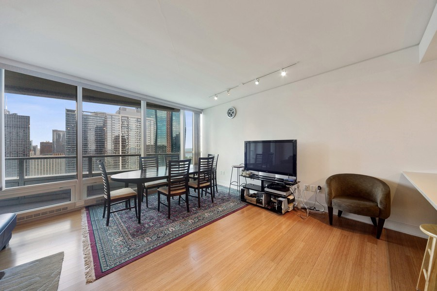 Real Estate Photography - 340 E Randolph St, Unit 2902, Chicago, IL, 60601 - Dining Room