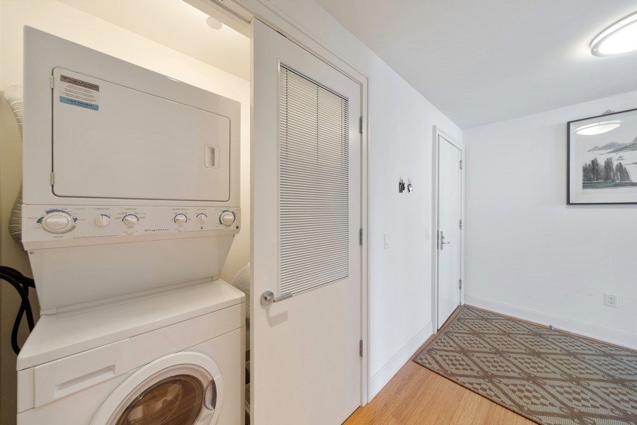 Real Estate Photography - 340 E Randolph St, Unit 2902, Chicago, IL, 60601 - Laundry Room