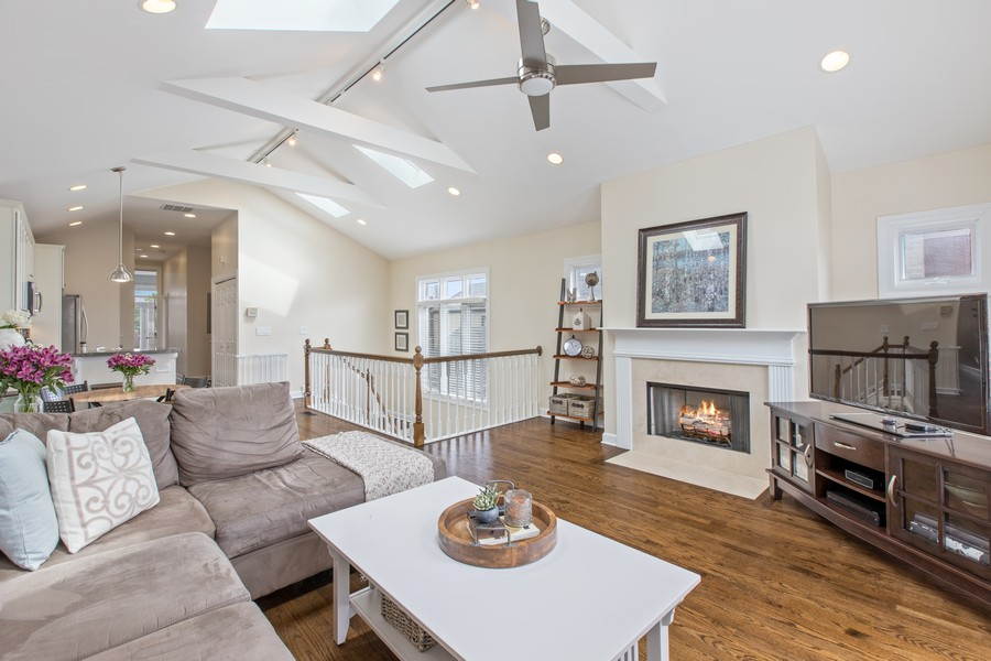 Real Estate Photography - 1226 West Melrose #3, Chicago, IL, 60657 - Living Room has High Peaked Ceiling & Ceiling Fan