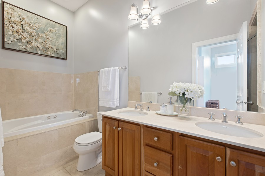 Real Estate Photography - 1226 West Melrose #3, Chicago, IL, 60657 - Master Bathroom has Double Vanity & Whirlpool Tub