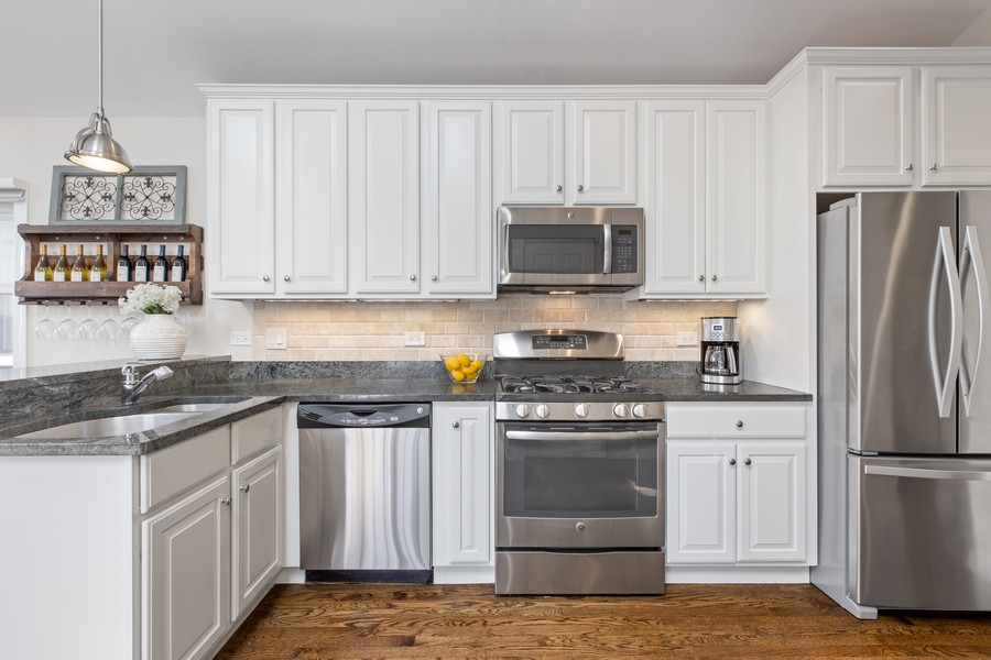 Real Estate Photography - 1226 West Melrose #3, Chicago, IL, 60657 - Kitchen with Stainless Steel Appliances & Granite