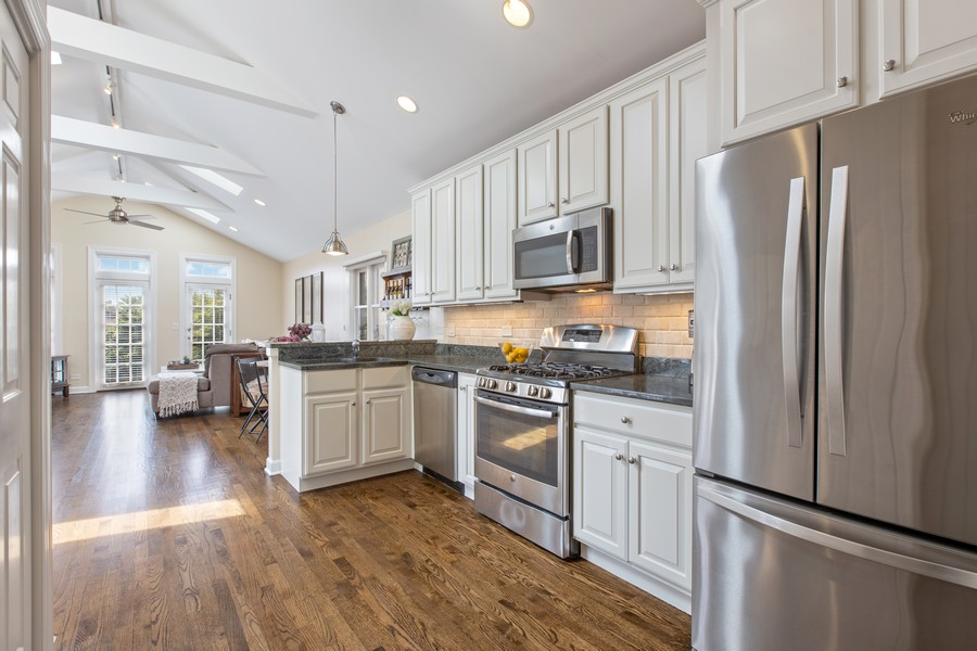 Real Estate Photography - 1226 West Melrose #3, Chicago, IL, 60657 - Kitchen open to Dining & Living Room