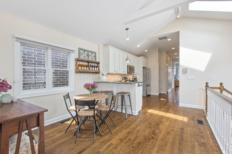 Real Estate Photography - 1226 West Melrose #3, Chicago, IL, 60657 - Dining Space open to Kitchen with Peninsula