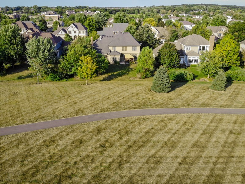 Real Estate Photography - 4N530 School, St. Charles, IL, 60175 - Drone footage of the home from the backyard filed