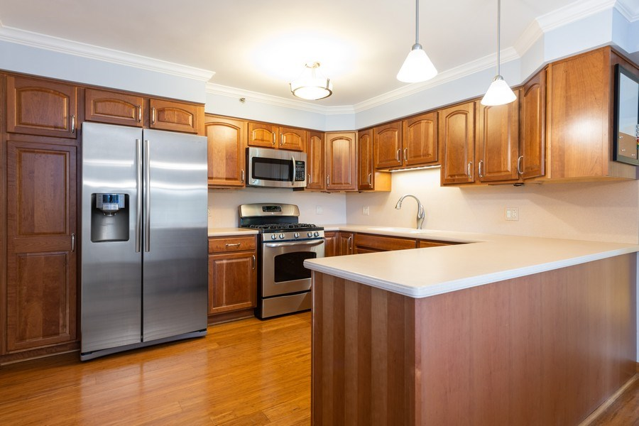 Real Estate Photography - 1220 Depot, Unit 415, Glenview, IL, 60625 - Kitchen