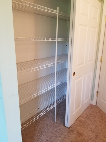 Real Estate Photography - 1220 Depot, Unit 415, Glenview, IL, 60625 - 2nd Master closet