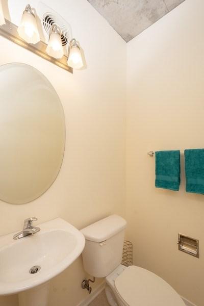 Real Estate Photography - 700 W Van Buren St, Unit 703, Chicago, IL, 60607 - Half Bath