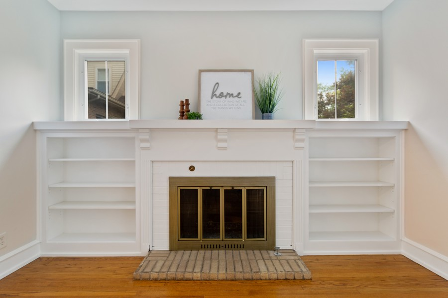 Real Estate Photography - 285 N Main St, Glen Ellyn, IL, 60137 - Living Room.  Wood burning fireplace with custom m