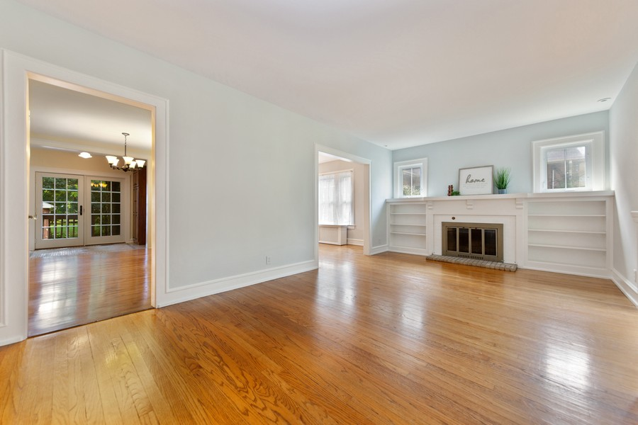 Real Estate Photography - 285 N Main St, Glen Ellyn, IL, 60137 - Living Room.  Great way to welcome guests.