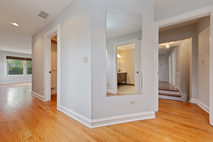 Real Estate Photography - 285 N Main St, Glen Ellyn, IL, 60137 - Master Bedroom.  Transitional Hallway in Master Su