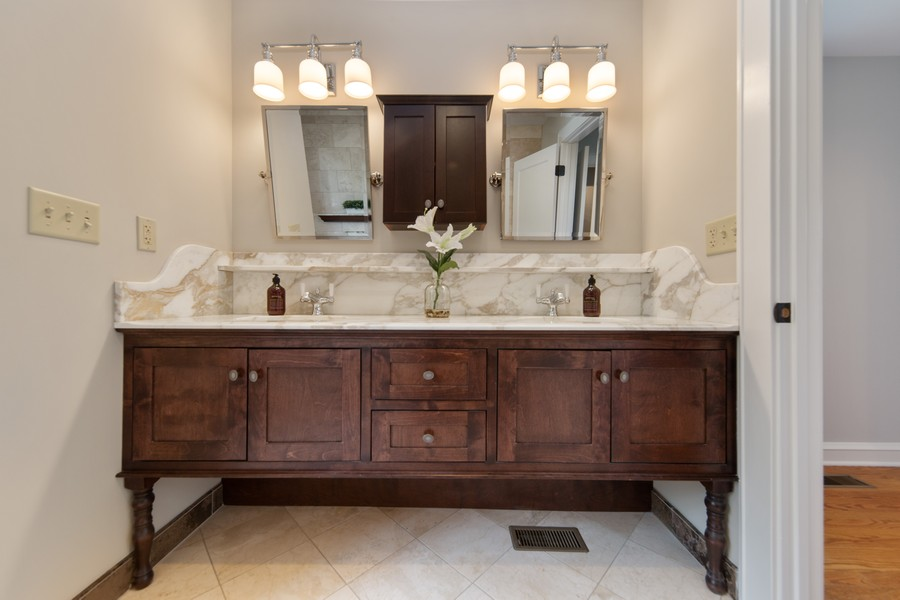 Real Estate Photography - 285 N Main St, Glen Ellyn, IL, 60137 - Master Bathroom.  Double Bowl Sinks