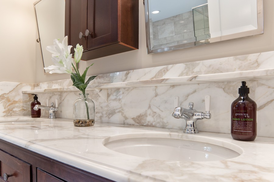 Real Estate Photography - 285 N Main St, Glen Ellyn, IL, 60137 - Master Bathroom.  Carrera Marble Countertops and b