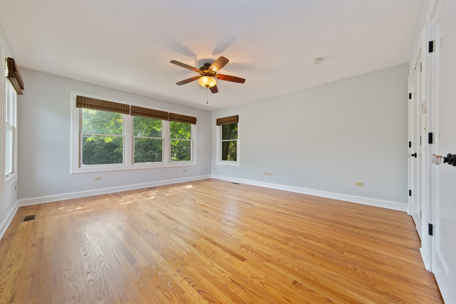 Real Estate Photography - 285 N Main St, Glen Ellyn, IL, 60137 - Master Bedroom.  Comfortable space with windows ov
