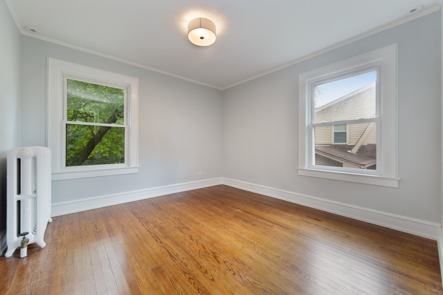 Real Estate Photography - 285 N Main St, Glen Ellyn, IL, 60137 - 3rd Bedroom.  Bright and lovely space
