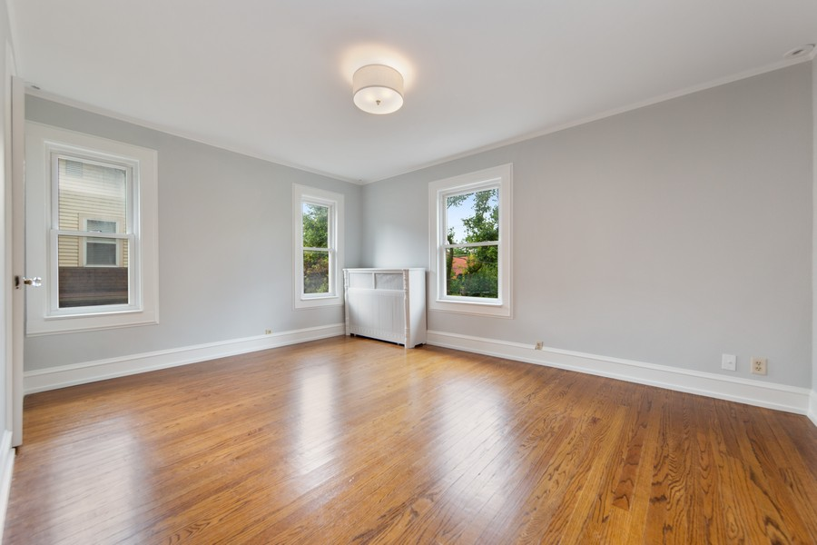 Real Estate Photography - 285 N Main St, Glen Ellyn, IL, 60137 - 4th Bedroom.  All newly painted white trim