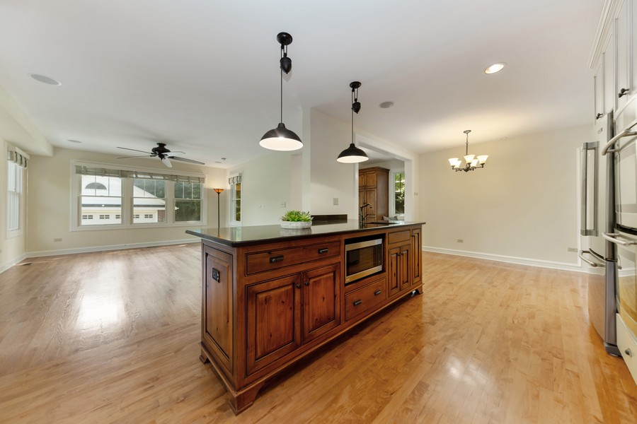 Real Estate Photography - 285 N Main St, Glen Ellyn, IL, 60137 - Kitchen.  Large island overlooking the family room