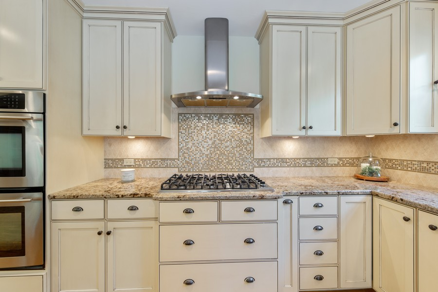 Real Estate Photography - 285 N Main St, Glen Ellyn, IL, 60137 - Kitchen.  Stainless Steel appliances and ample cou