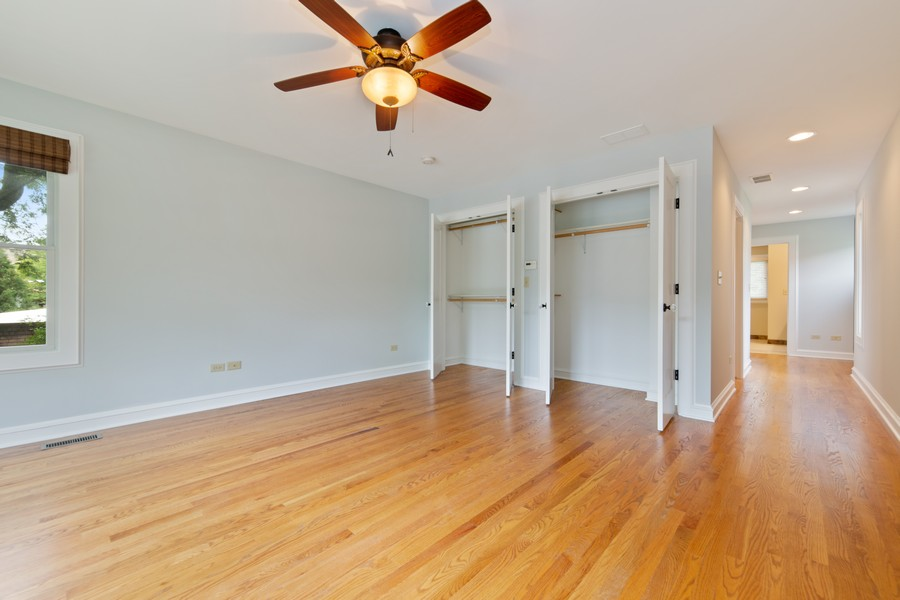 Real Estate Photography - 285 N Main St, Glen Ellyn, IL, 60137 - Master Bedroom.  Neutral paint colors. Double clos