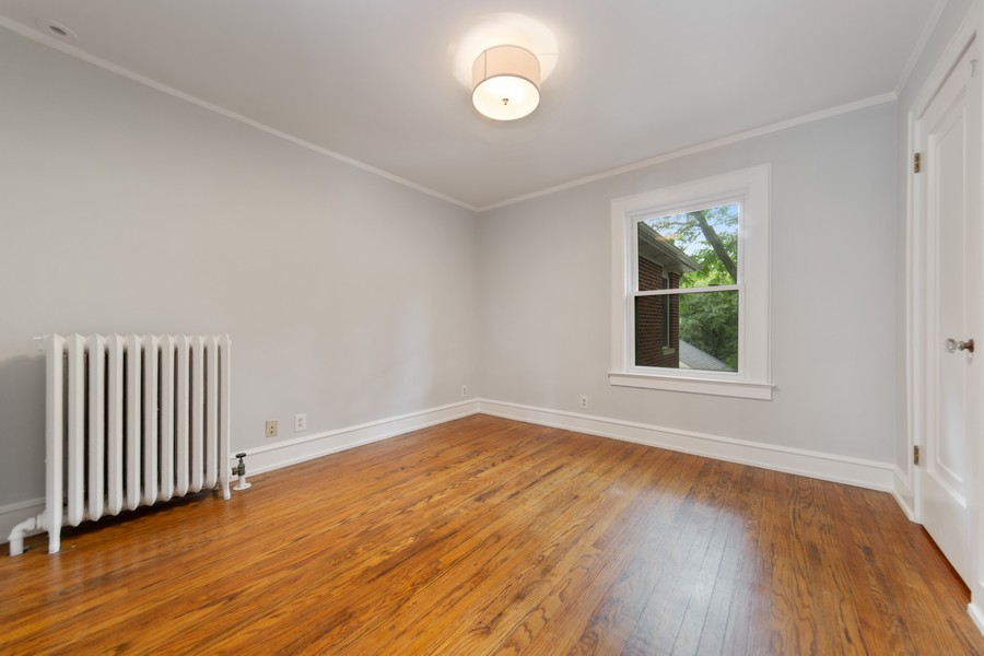 Real Estate Photography - 285 N Main St, Glen Ellyn, IL, 60137 - 2nd Bedroom.  Neutral paint.
