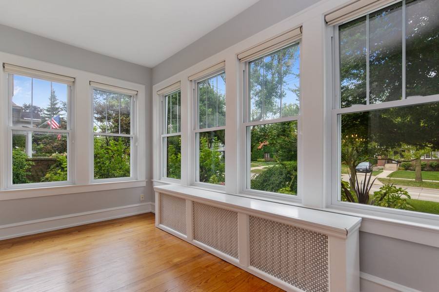 Real Estate Photography - 285 N Main St, Glen Ellyn, IL, 60137 - Sun Room.  You'll see why they call this a sun roo