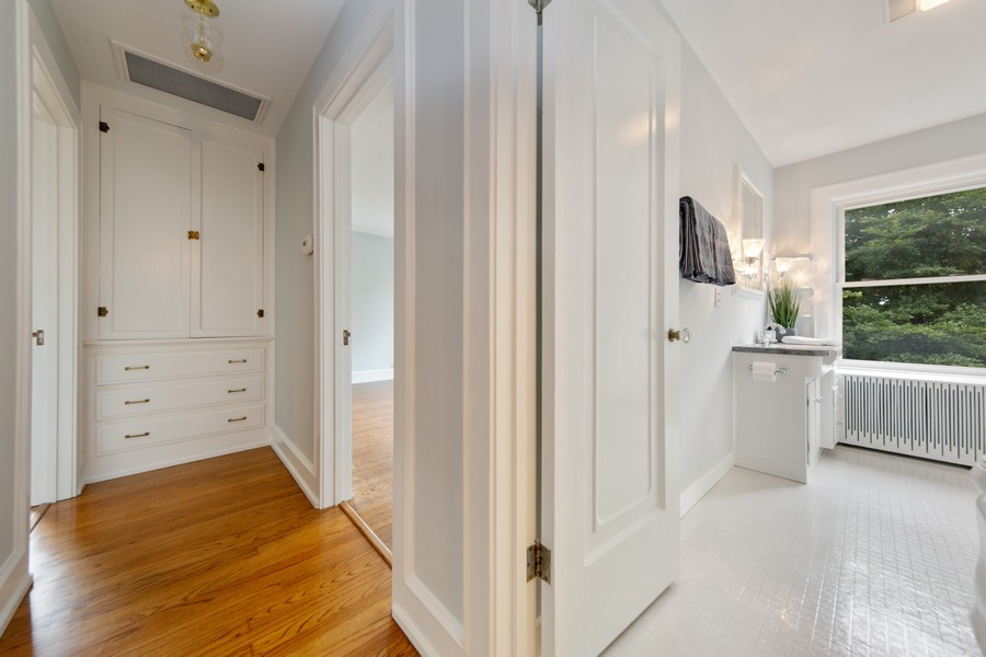 Real Estate Photography - 285 N Main St, Glen Ellyn, IL, 60137 - Hallway.  Hallway directing towards the bedrooms a