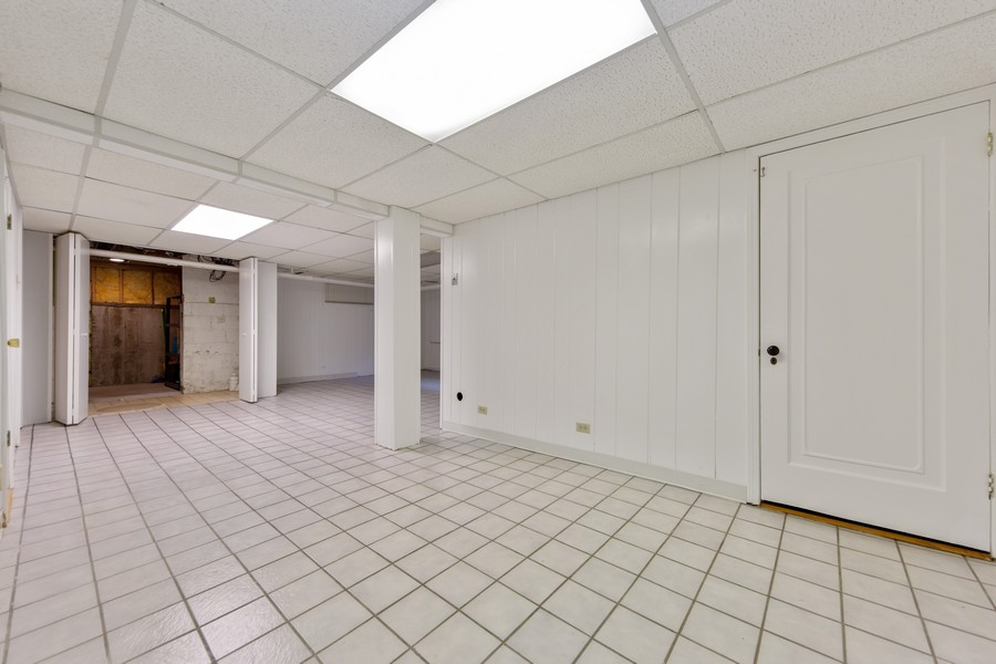 Real Estate Photography - 285 N Main St, Glen Ellyn, IL, 60137 - Basement.  Bright space with lots of lighting.