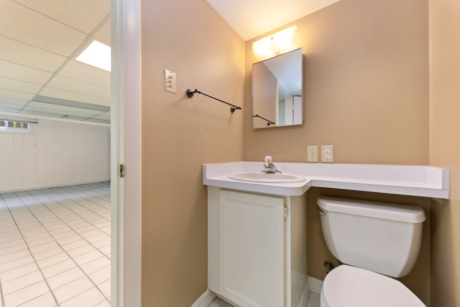 Real Estate Photography - 285 N Main St, Glen Ellyn, IL, 60137 - 1/2 Bath.  Located in the basement.