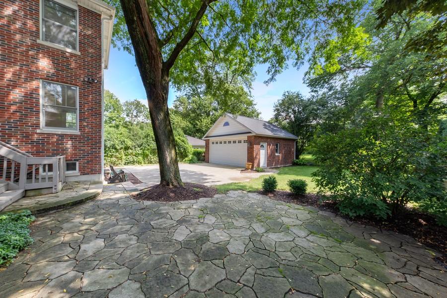 Real Estate Photography - 285 N Main St, Glen Ellyn, IL, 60137 - Exterior Back.  Quaint flagstone patio for enterta