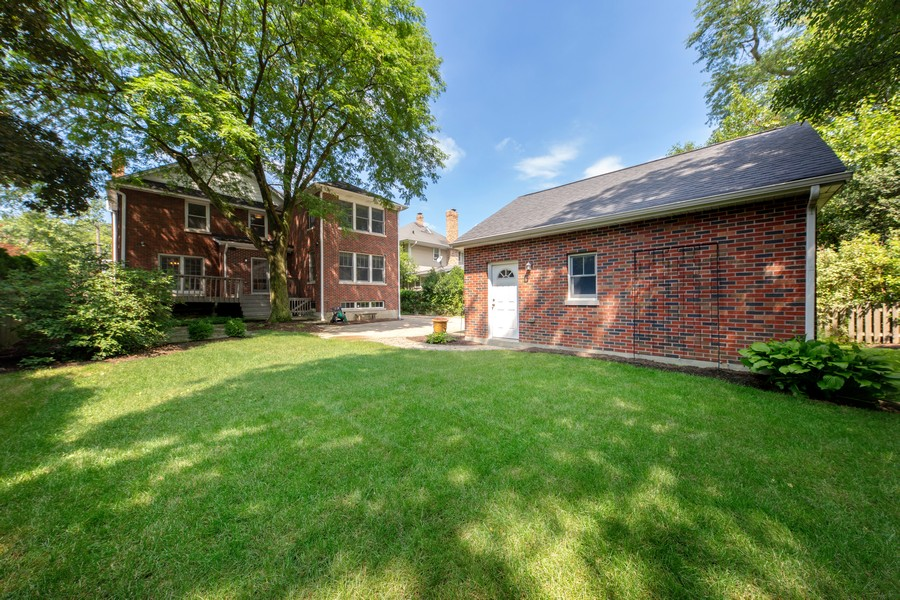 Real Estate Photography - 285 N Main St, Glen Ellyn, IL, 60137 - Exterior Back. Plenty of space to enjoy all things